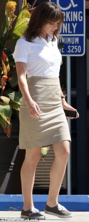 Cute and casual: Katharine made her fitted shirt, beige skirt and brown lace-up flats look lovely