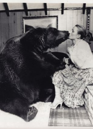 Maggie Robin, pictured here, became so close to the grizzly bear Hercules that he dined with them. Maggie kissed and cuddled the bear without any fear and says he was 'part of the family'