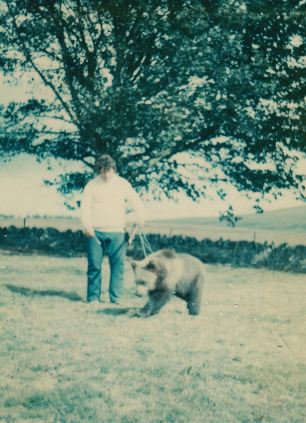 Andy takes Hercules out for a stroll in Scotland, where he trained the bear every day to compete in wrestling tournaments
