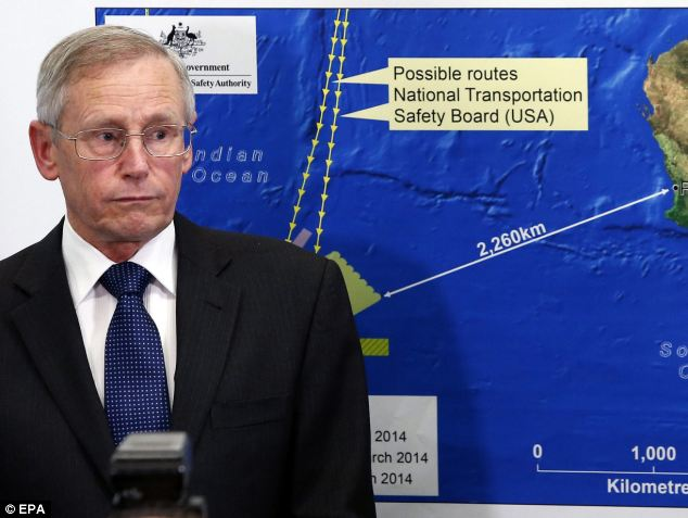 Australian Maritime Safety Authority (AMSA) general manager John Young is seen next to an AMSA graphic map during a press conference on the search for the Malaysia Airlines flight MH370