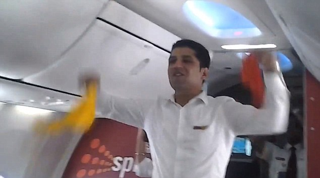 Dance routine: Passengers can be heard on the video clapping and cheering to the routine by SpiceJet staff