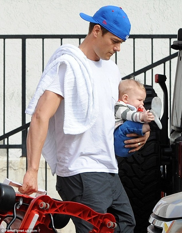 Daddy duty: Josh Duhamel and baby son Axl enjoyed some father-son bonding on Thursday, heading out for breakfast near their home in Brentwood, California