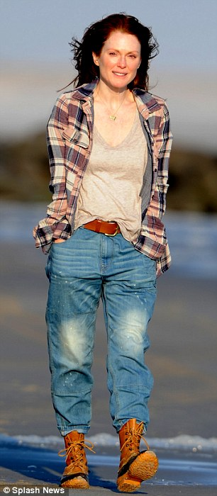 Winter's chill: The actress was dressed in a pair of baggy jeans tucked into waterproof laced up boots with a grey T-shirt and flannelette top