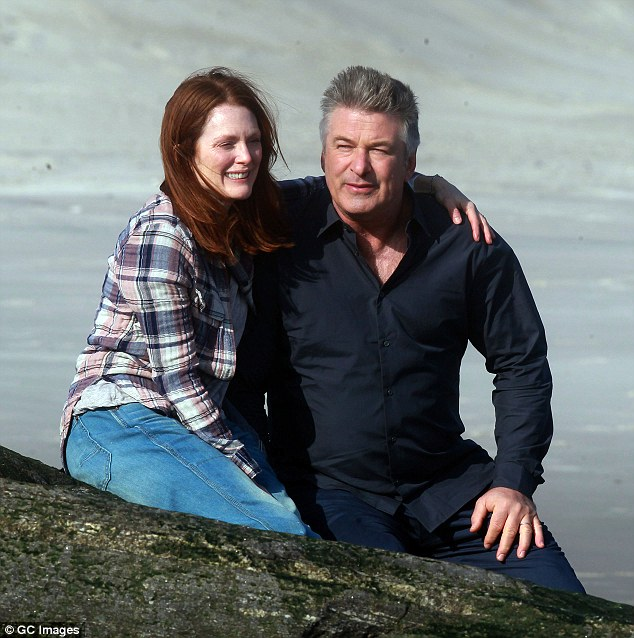 Smiling through sadness: While the film has a sad storyline - Still Alice follows Julianne's character after she finds out she has early onset Alzheimer's - 55-year-old Alec and the actress shared a laugh as the cameras kept rolling after their kiss