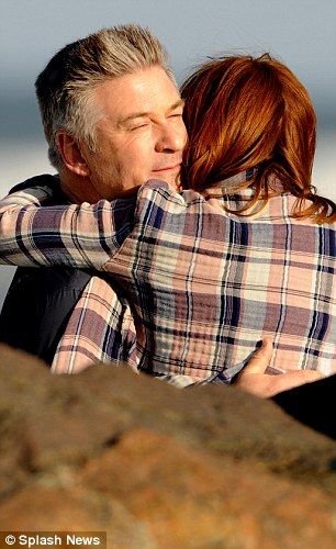 Not letting go: Dr. John Howland must come to grips with his wife's diagnosis and, it appears in this scene, he realises that while the woman he loves is going through changes, but she is still the person he married