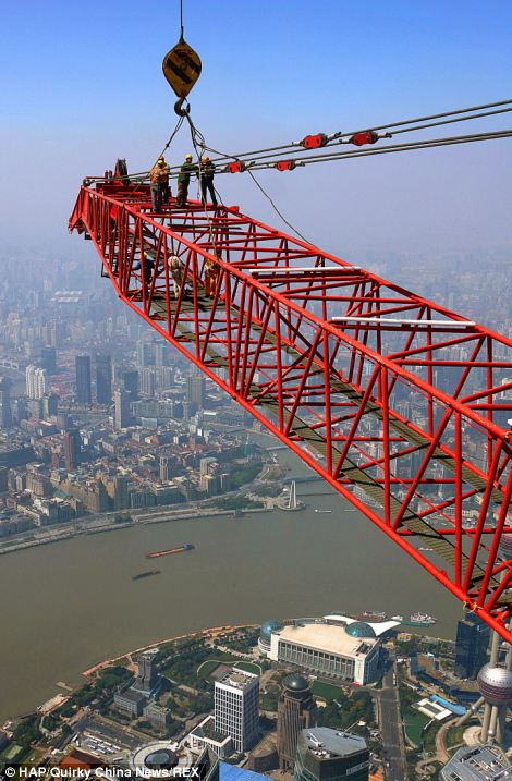 Bird's eye view: The skyscraper is expected to open to the public in 2015 - standing at a knee-wobbling 2,073ft tall with more than 120 stories