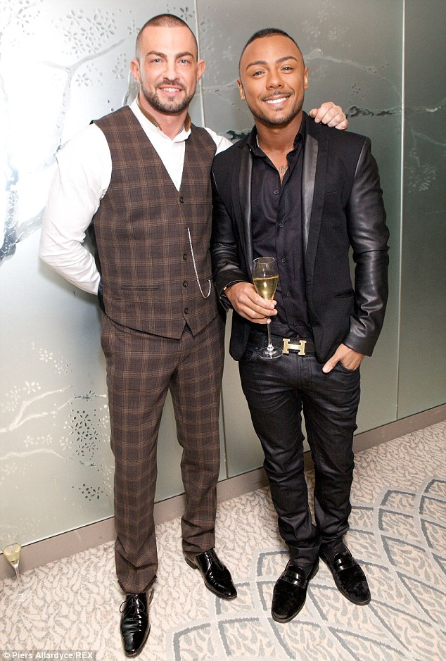 Lovely couple: X Factor's Marcus Collins and Robin Windsor look happy together at the 25th Anniversary Stonewall Equality Dinner in London on Thursday night