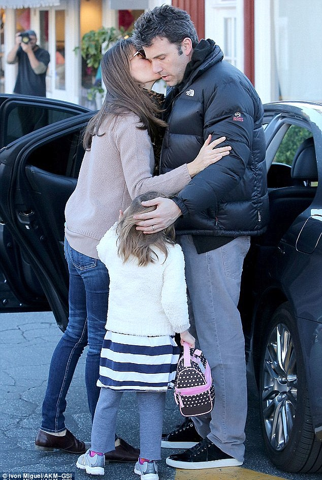 One of Hollywood's most romantic couples: Jennifer gives husband Ben  a loving kiss last month