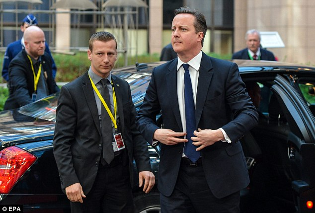 David Cameron's expression was stern today when arriving at the summit in contrast to Mrs Thorning-Schmidt's wide grin