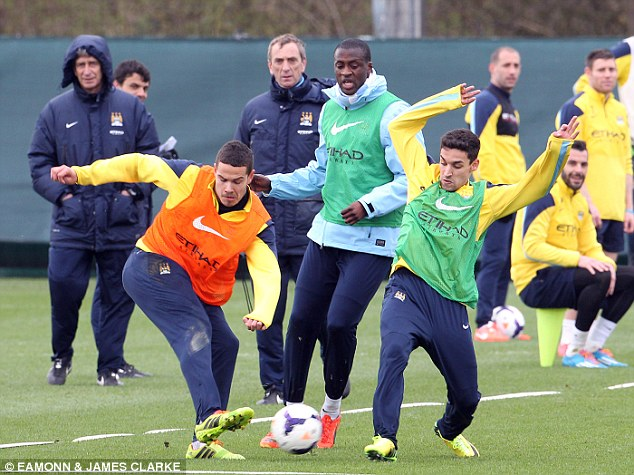 Getting stuck in: Jack Rodwell (left) and Jesus Navas (right) weren't holding back as Yaya Toure kept an eye