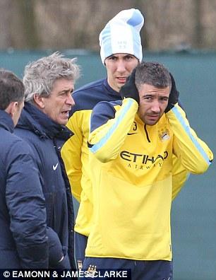 Ear we go: Aleksandar Kolarov keeps out the cold