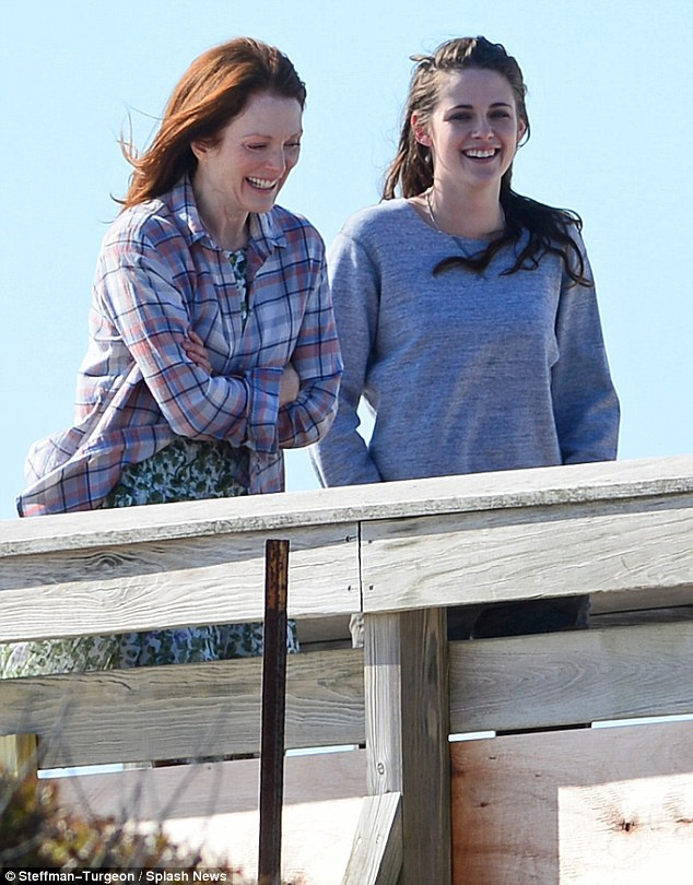 Mother-daughter bonding: Kristen Stewart enjoyed a wholehearted laugh with on-screen mom Julianne Moore as the paired filmed scenes for their new movie, Still Alice, in Long Beach, New York on Friday