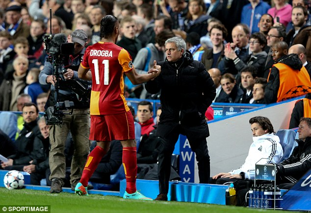 Friends reunited: Didier Drogba (L) and former manager Jose Mourinho embrace ahead of the game