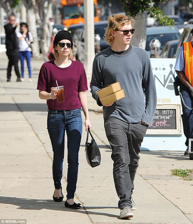 Happy couple: Emma and her fiancé, actor Evan Peters, 27, out and about in Los Angeles on Friday