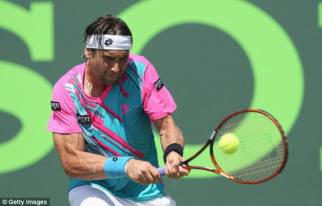 Colourful: No 4 seed David Ferrer plays a backhand during his victory over Teymuraz Gabashvili