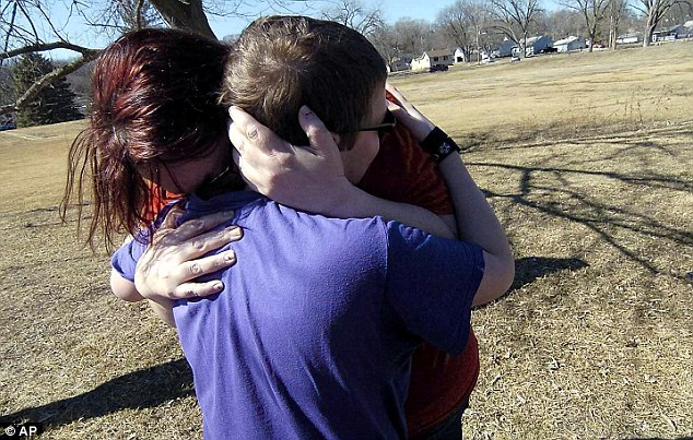 Emotional reunion: Corbin Crawford runs to the arms of his mother, Barbara Crawford, following the rescue
