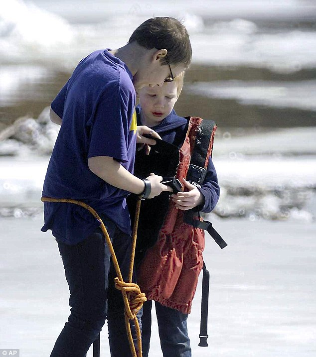 The rescue, which took about 45 minutes, involved firefighters throwing rope at the boys in order to send them life jackets