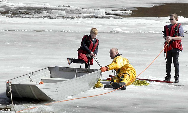 he firefighters helped get a flat-bottomed aluminum boat to the boys, which they used to pull them to shore