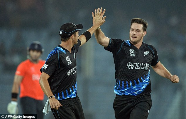 High-five: New Zealand's Mitchell McClenaghan (right) celebrates taking the wicket of Lumb