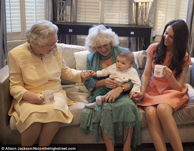 Centre of attention: Camilla is left holding the baby as the Queen and Kate sup tea from mugs with apt slogan 'Mummy rules' in one of the final images