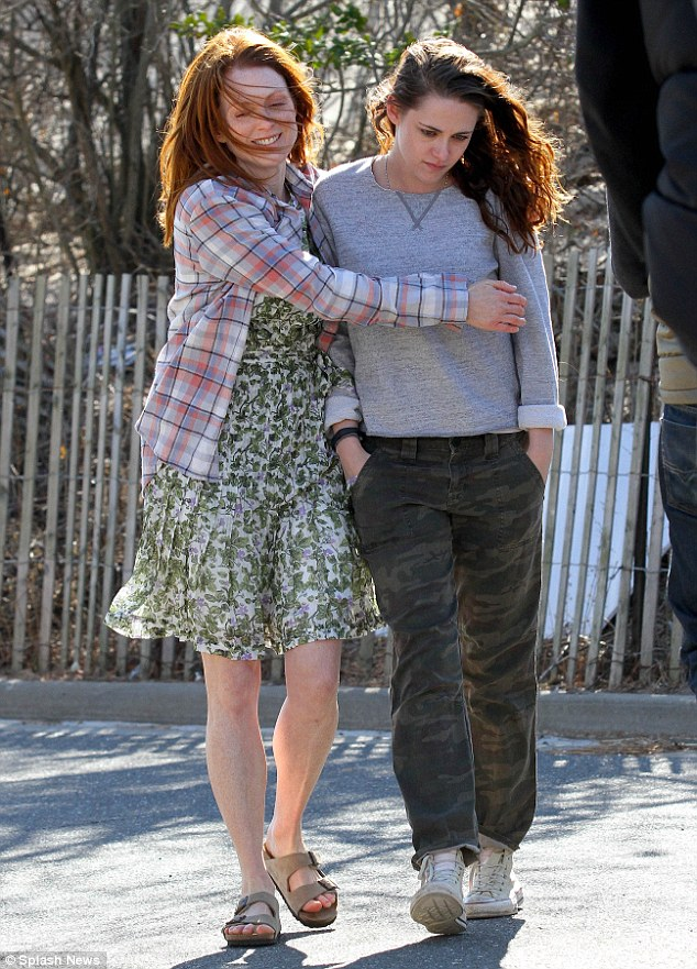 Family time: The ever-youthful Julianne smiled as she put an arm around her grumpy co-star