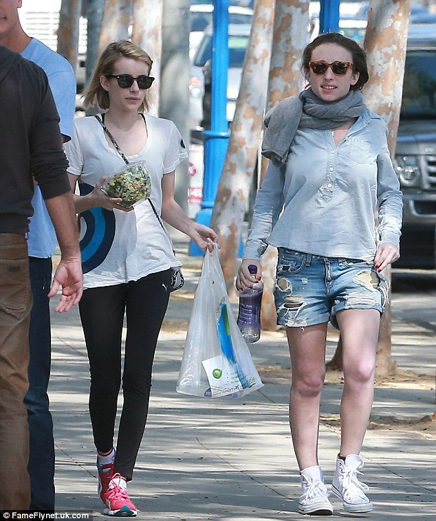 Casual chic: Emma out and about with a friend later on in the day