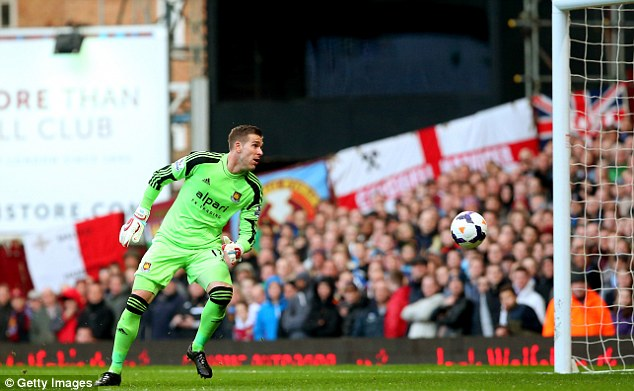 Misjudged: Goalkeeper Adrian looks on in vain as the long range shot from Rooney goes over his head