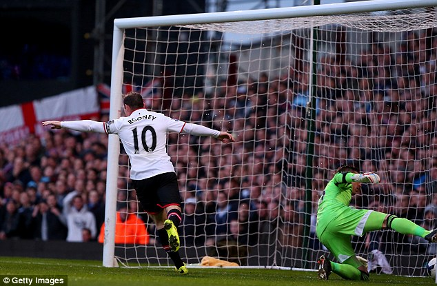 Double up: Rooney slots home United's second after a defensive mishap from West Ham
