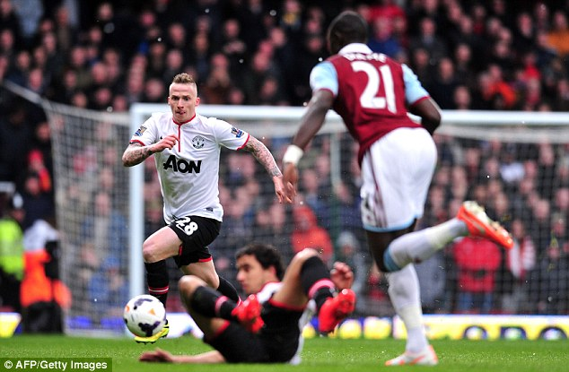 Tussle: Alex Buttner prepares to challenge Mohamed Diame in midfield
