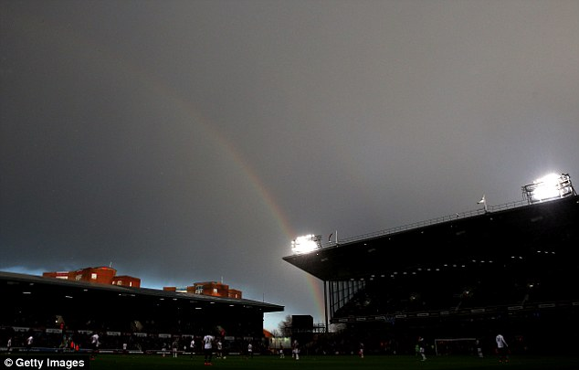Picturesque: A rainbow is seen over a grey Upton Park in east London