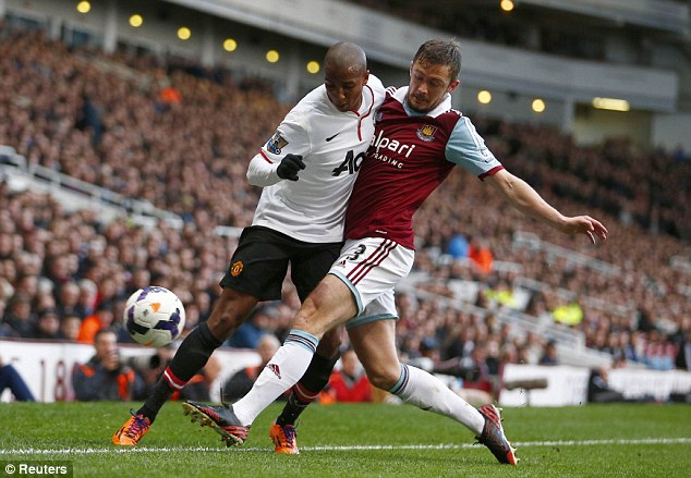 Foot in: George McCartney (right) challenges Manchester United's Ashley Young