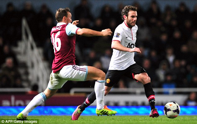 Knocked off: Juan Mata looks composed on the ball as Mark Noble attempts to close him down