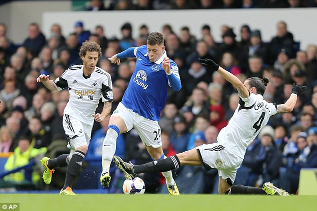 Foot in: Chico Flores makes a tackle on Barkley