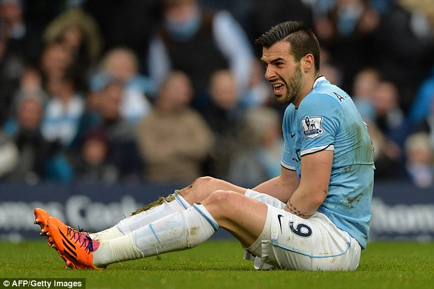 Ouch: The Spaniard feels sorry for himself on the floor, but at least he earned his side a spot-kick