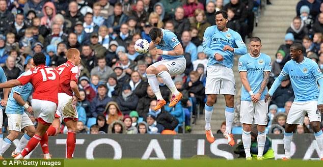 Commitment: Negredo puts his body in the way to stop Kieran Richardson's free-kick