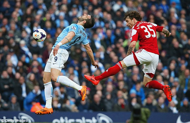 Cynical: Amorebieta picks up his first yellow card for kicking Alvaro Negredo in the backside