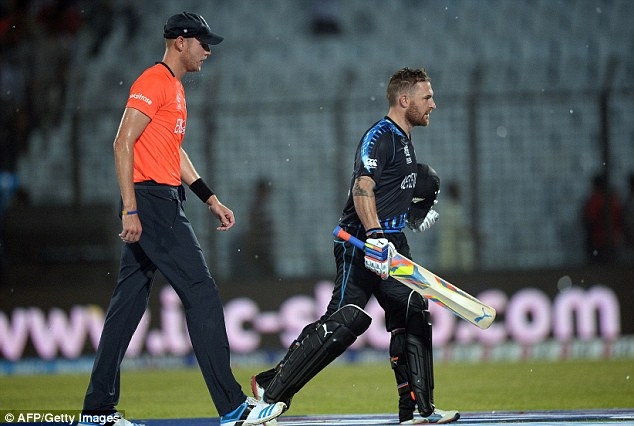 Off you go: England captain Stuart Broad follows New Zealand skipper Brendan McCullum as play's suspended