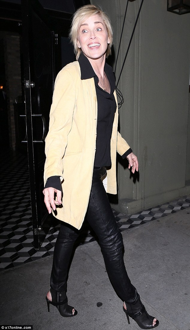 Flawless: Sharon Stone flashed a huge smile for photographers as she left Craig's in West Hollywood last night