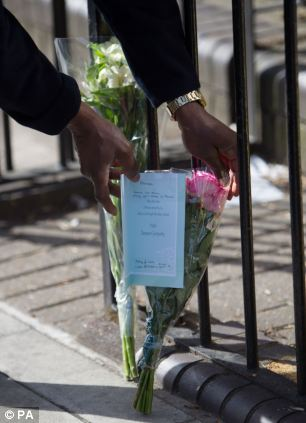 A police officer lays flowers