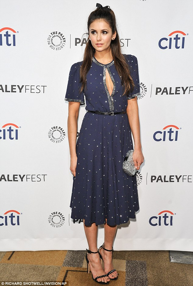 Stylish: Nina, who stars in the Vampire Diaries, looked sophisticated in a classic dress that sparkled under the lights and showed off her cleavage