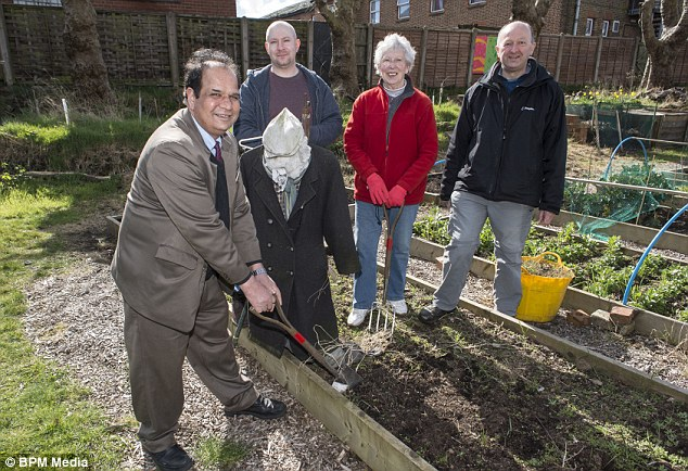 Digging in: Sue Godridge pictured with Councillor Chaman Lal, Scott Tidman  and Andrew Simons, hopes James Turner Street can win Britain in Bloom