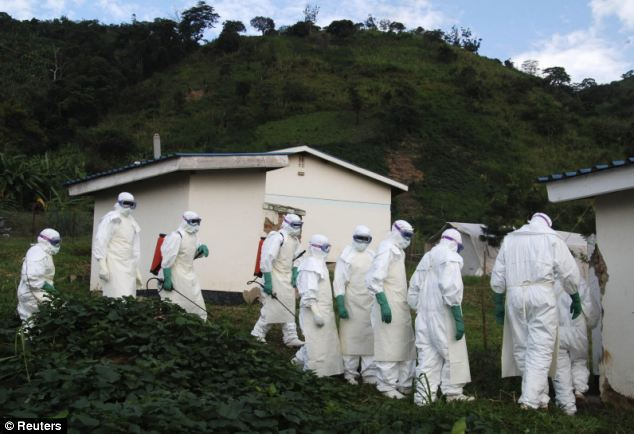 Ebola was first spotted in Uganda and Democratic Republic of Congo, where Medicins Sans Frontieres workers pictured are pictured at an isolation unit. They are now stepping up units and work force in Guinea