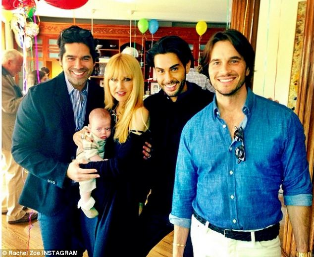 The happy family: Zoe held her newborn Kaius alongside Brian Atwood, Joey Maalouf, and ER doctor Jake Deutsch