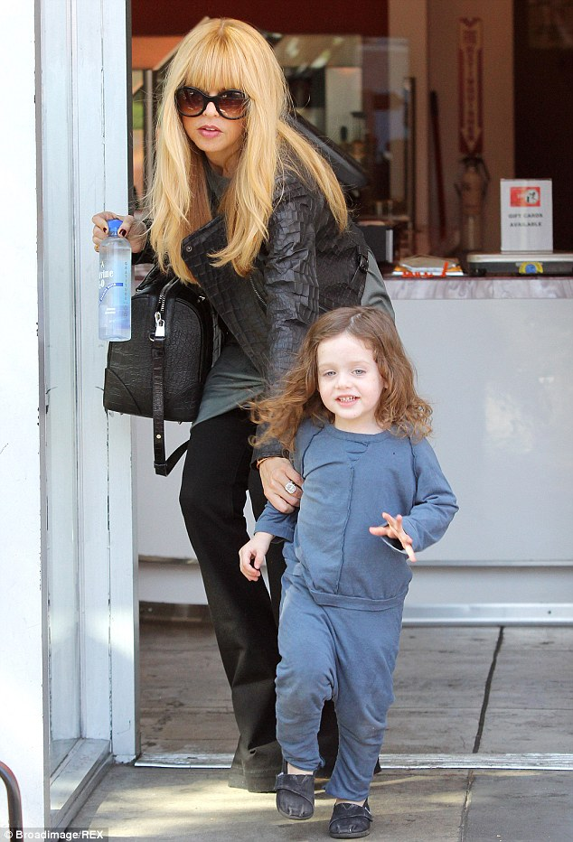 The doting mother: The Rachel Zoe Project star protectively reached for her young son's hand as they ventured outside in Los Angeles in February