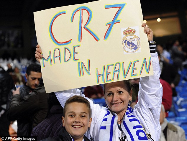 Made in heaven: Two Real Madrid fans show their appreciation for star man Cristiano Ronaldo