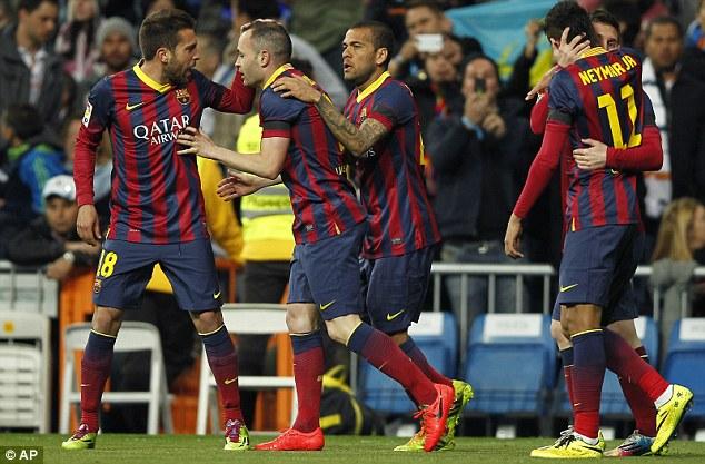 Team effort: Iniesta is congratulated by Jordi Alba (left) and Dani Alves (centre) as Neymar and Messi embarce