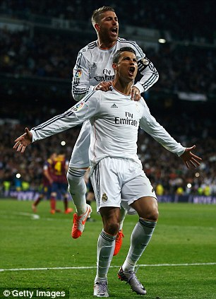 Flying high: Sergio Ramos celebrates Madrid's third with Ronaldo (left) while the Madrid star jumps for joy (right)