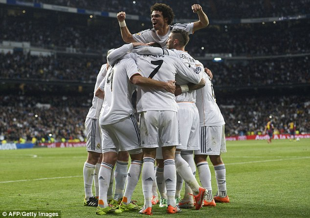 Top of the pile: Pepe (centre) celebrates with the rest of his Madrid team-mates following Real's third goal