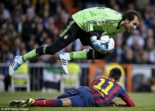 Safe hands: Real Madrid goalkeeper Diego Lopez gathers the ball and jumps over Neymar
