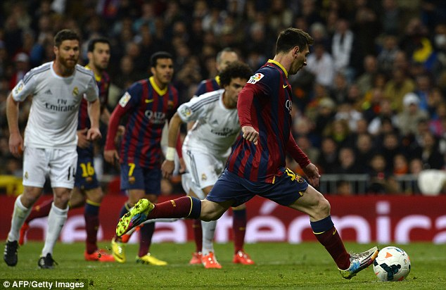 From the spot: Lionel Messi strokes the ball home to clinch a 4-3 victory for Barcelona against Madrid